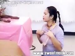 Thai Girl Riming a Dog